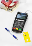 Payment terminal for paying by card and a pen and yellow cutter Stock Photo