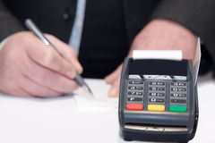 Payment terminal, payment by card. Man pay for purchases  credit card through the bank terminal Stock Image