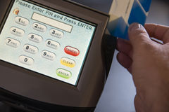 Payment terminal with PIN entry screen. Card swipe motion shot on terminal showing pin entry Stock Images