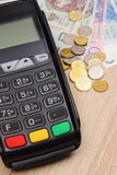 Payment terminal with polish currency, credit card machine on desk, finance concept Stock Photos