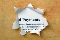 Payment text on paper hole Royalty Free Stock Photo