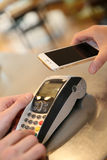 Payment transaction with smartphone Royalty Free Stock Photography