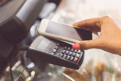 Payment transaction with smartphone Stock Photos