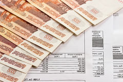 Payment of utilities and Russian money. Receipt for payment of utilities and Russian money Royalty Free Stock Photo