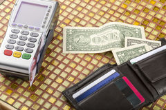 Payment wireless terminal and wallet with banknotes Royalty Free Stock Images