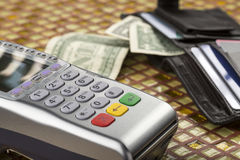 Payment wireless terminal and wallet with banknotes Stock Photography