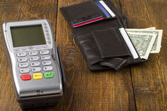 Payment wireless terminal and wallet with dollar banknote Royalty Free Stock Photo