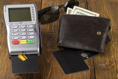 Payment wireless terminal and wallet with dollar banknote Royalty Free Stock Images