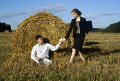 Payment for work. Teamwork at the field. two person and laptop Royalty Free Stock Photo