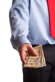 Payoff. A business man offering money as concept for corruption Stock Images
