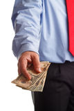 Payoff. A business man offering money as concept for corruption Royalty Free Stock Photography