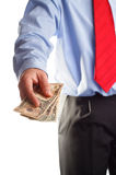 Payoff. A business man offering money as concept for corruption Stock Photo