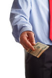 Payoff. A business man offering money as concept for corruption Stock Photography