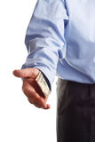 Payoff. A business man offering money as concept for corruption Royalty Free Stock Photo