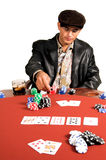 The payoff. Hispanic man  playing Texas Hold um poker Royalty Free Stock Photos