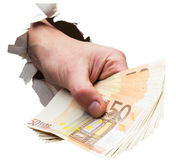 Payoff. Hand full of money breaking through wall Stock Photos