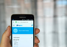 PayPal on a cell phone. stock photography