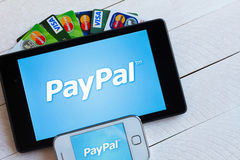 PayPal payment system logo on tablet and smartphone Royalty Free Stock Photography