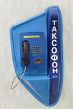 Payphone. Blue payphone on the wall, closeup Stock Photo