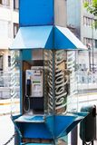 Payphone on a city street. Old payphone on a city street royalty free stock images