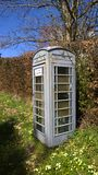 Payphone rural. Grey GPO / BT payhone painted green to blend into a rural surrounding, K6 as seen in London etc Stock Photos