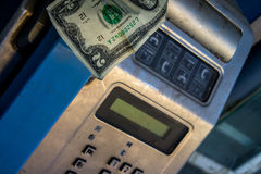 Payphone with us dollar note inside Royalty Free Stock Image