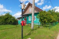 Payphone in the village. Volgoverkhovie. Tver region. Russia stock image
