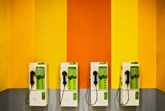 Payphone on the wall public Stock Images