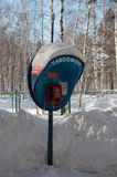 Payphone in winter forest Stock Photo