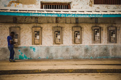 Payphones in Cuba. CUBA in December 2015: A male person uses a public payphone to make a call. Public phones are the only telephones for many people in Cuba Royalty Free Stock Image
