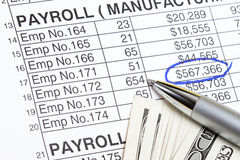 Payroll. Abstract with US dollars and  spreadsheet Stock Photography