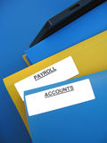 "Payroll Accounts. Blue and yellow folders sitting on an office tray. One folder is labeled ""PAYROLL"". Another folder is labeled ""ACCOUNTS stock images"