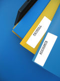 "Payroll Accounts. Blue and yellow folders sitting on an office tray. One folder is labeled ""PAYROLL"". Another folder is labeled ""ACCOUNTS royalty free stock image"