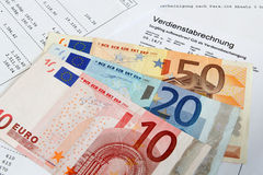 Payroll with banknotes Stock Photo