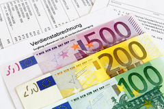 Payroll with banknotes Stock Photos