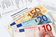 Payroll with banknotes Stock Image
