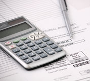 Payroll and calculator royalty free stock image