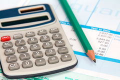 Payroll with calculator and pencil Royalty Free Stock Image