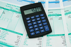 Payroll details. Black calculator and payroll summary details