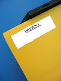"Payroll Folder. A yellow folder sitting on an office tray. The word ""PAYROLL"" is printed on the label royalty free stock photos"