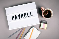 Payroll. Text in light box stock images