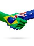 Pays d'Australie du Brésil de drapeaux, concept de poignée de main d'amitié d'association Images stock