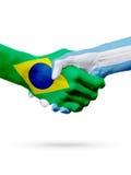 Pays du Brésil Argentine de drapeaux, concept de poignée de main d'amitié d'association Photographie stock