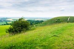 Paysage anglais vu d'une colline le jour obscurci Photo stock