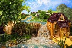 Paysage avec le moulin à eau fait à partir de la nourriture Image stock