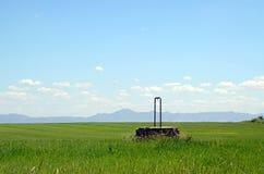 Paysage avec un puits d'eau Images libres de droits
