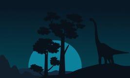 Paysage d'arbre et de brachiosaurus des silhouettes Images stock