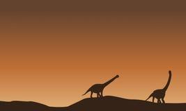 Paysage d'argentinosaurus sur la colline Photographie stock libre de droits