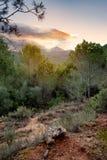 Paysage d'une vallée au coucher du soleil Photos stock