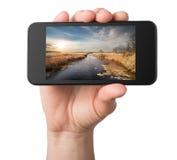 Paysage dans un téléphone Photo stock